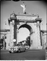 Historic photo from 1965 - CNEs first marathon car rally - car 305, leaving CNE grounds via Princes Gates in CNE