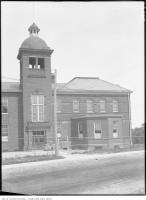 Historic photo from Thursday, July 19, 1928 - Windermere School, Swansea, exterior with baby prams out front in Swansea