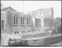 Historic photo from Friday, August 3, 1928 - Demolishing old Jarvis Collegiate (1871-1924) view from the south in Garden District