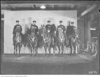 Historic photo from Thursday, November 28, 1929 - Royal Winter Fair, mounted Police - Sergeant Chalklin, Police Constable Hill, P.C. Hanier, P.C. Harvey, Patrol Sergeant Masters in CNE