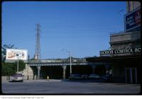 Historic photo from Tuesday, July 17, 1973 - View of CPR overpass on Yonge Street with Liquor Control Board sign in Rosedale
