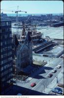 Historic photo from Saturday, April 5, 1980 - St. Andrew's Presbyterian Church with Roy Thompson Hall under construction  in King Street West