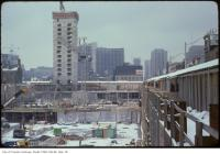 Historic photo from Thursday, February 6, 1975 - View of a snow-covered Eatons Centre construction site looking south in City Hall