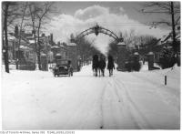 Historic photo from Friday, December 25, 1925 - Christmas day horses at the Howard Memorial Gates in High Park