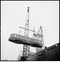 Historic photo from 1966 - Loading of streetcars onto ship named SHUN-EI MARU : Pier 28 off Polson in Cherry Beach