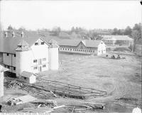 Historic photo from 1947 - Sunnybrook farm, East York Twp : exterior view of the barns and stables in Sunnybrook Park