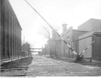 Historic photo from Tuesday, November 19, 1918 - View looking south on Trinity Street, showing to the right the M. E. K. still and tank houses in Distillery District