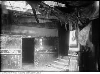 Historic photo from Monday, May 10, 1915 - Princess Theatre ruins - ornate trim, stairs, broken mirrors, and firehose in Downtown