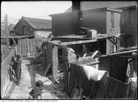 Historic photo from Tuesday, May 8, 1917 - Building a brick addition at the rear of 41 Huron in Chinatown (Spadina Ave)