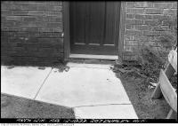 Historic photo from Wednesday, April 12, 1933 - Spalled brickwork - 207 Duplex Avenue in Chaplin Estates