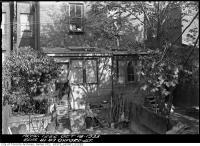 Historic photo from Wednesday, October 18, 1933 - Curtains, wood, and carpets at the rear of 81-83 Oxford Street in Kensington Market
