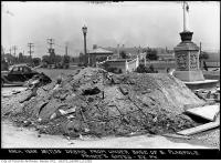 Historic photo from Thursday, July 18, 1935 - Debris from under base of south flagpole Princes Gates, C.N.E. in CNE