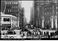 Historic photo from Friday, May 19, 1939 - Decorations for visit of King George VI - looking south down Bay from Queen in City Hall