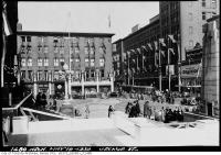 Historic photo from Friday, May 19, 1939 - Decorations for visit of King George VI - looking east to T. Eatons Co. building in City Hall