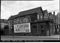 Historic photo from Friday, April 26, 1940 - Laundry and ads at 165 St. Clarens Avenue in Brockton Village