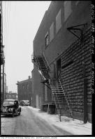 Historic photo from Thursday, January 15, 1942 - Fire escape and car in alley along the side of 215 Mavety Street in The Junction