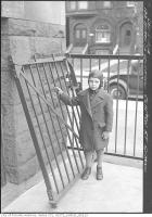 Historic photo from Monday, December 3, 1934 - Boy outside Clinton St. School re: iron fence in Bickford Park