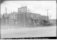 Historic photo from Tuesday, July 4, 1922 - Ads for Macdonalds Brier and Cigarettes - southwest corner of Munro and Gerrard Streets in Riverside-South Riverdale