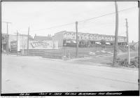 Historic photo from Tuesday, July 4, 1922 - Row houses and White Bros Clothing on Payments sign - southeast corner of Gerrard and Blackburn Streets in Riverside-South Riverdale