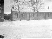 Historic photo from Saturday, February 3, 1912 - Old wooden houses  - 174 Sackville Street just north of Shuter in Regent Park