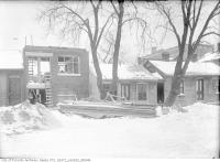 Historic photo from Friday, February 23, 1912 - Old houses and partial building, including 104 Elm Street in Discovery District