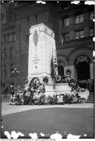 Historic photo from Wednesday, November 11, 1925 - Cenotaph, City Hall - decorated with wreaths, Remembrance Day, view from south in City Hall