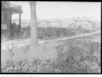 Historic photo from Tuesday, September 9, 1913 - Fence and houses around Dufferin Grove park in Dufferin Grove