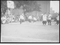 Historic photo from Wednesday, August 26, 1914 - Playing basketball at St. Andrews playground with the market building behind in Alexandra Park