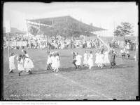 Historic photo from Wednesday, September 1, 1915 - Bleachers behind kids playing at the Model Playground - Exhibition Grounds in CNE