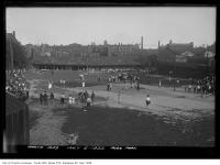 Historic photo from Wednesday, July 5, 1922 - Moss Park - field day with city in background (Plate Glass Co.) in Moss Park