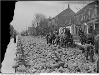 Historic photo from Wednesday, April 12, 1911 - Horsedrawn carts and manual labour on Wilton, west from Sumach in Regent Park