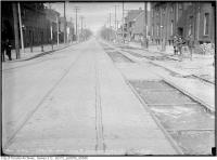 Historic photo from Thursday, May 4, 1916 - Palace Hotel on leftt, at King and Strachan Ave. looking east Track reconstruction in Stanley Park