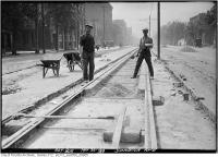 Historic photo from Friday, May 30, 1919 - 2 men  working on new streetcar tracks on Spadina Ave. in Chinatown (Spadina Ave)