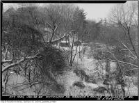 Historic photo from Tuesday, January 22, 1946 - Blythwood Road grading and paving - small outbuildings in the ravine hills in Sherwood Park