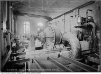 Historic photo from Thursday, October 28, 1915 - Two men posing next to machinery in the High Level Pumping Station in Republic of Rathnelly