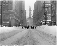 Historic photo from Monday, December 11, 1944 - Playing Street hockey on Bay Street south of Old City Hall after snowstorm (22.5 inches in 36 hours) in Downtown