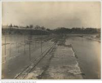Historic photo from Friday, February 9, 1900 - After the breakup of the Don River looking north from Gerrard Street bridge showing flooding in Riverdale park
