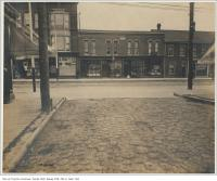 Historic photo from Wednesday, September 19, 1900 - Bicycle shop and Empire Laundry on Queen St. West looking south on Manning Avenue in Trinity Bellwoods