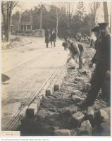 Historic photo from Thursday, November 12, 1903 - Laying bricks by hand on King Street opposite Wilson Park Road in King Street West