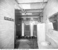 Historic photo from 1890 - Interior view of lavatory at the corner of Queen and Spadina in Alexandra Park