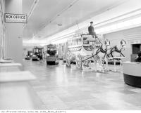 Historic photo from Monday, March 29, 1954 - Old vehicles in the auditorium foyer - 7th floor - Eatons College Street Store in College Street