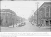 Historic photo from Tuesday, April 9, 1935 - Bathurst St, north, from Queen, before re-arrangement of poles in Trinity Bellwoods