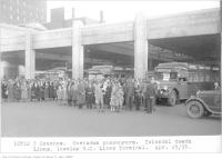 Historic photo from Thursday, April 25, 1935 - Overseas passengers of Colonial Coach Lines leaving Grey Coach Lines terminal in Downtown