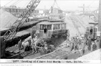 Historic photo from Tuesday, October 10, 1922 - Loading old cars to serve as  temporary housing in Haileybury, Ontario after fire in The Danforth