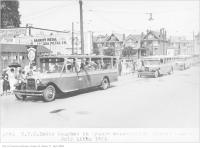 Historic photo from Saturday, July 11, 1925 - Chartered TTC buses southbound on Dufferin Street at Springhurst Ave for Orange Celebration in Parkdale