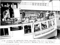Historic photo from Tuesday, May 22, 1928 - Patients taking the ferry to Lakeside home on Toronto Island on S.S. John Hanlan in Harbourfront