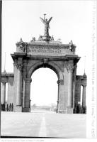 Historic photo from Wednesday, May 23, 1928 - Main Arch - Prince of Wales entrance, Exhibition Grounds with roller coaster in background in CNE