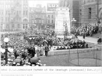 Historic photo from Sunday, November 18, 1928 - T.T.C. armistice parade, at the cenotaph with Ritz Hotel, Lux and Neilson ads in background in City Hall