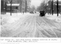 Historic photo from Tuesday, December 24, 1929 - Shuter St, east from Jarvis, showing condition of roadway after snowstorm, (Way Department) in Garden District