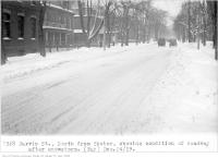 Historic photo from Tuesday, December 24, 1929 - Jarvis St, north, from Shuter, showing condition of roadway after snowstorm in Garden District